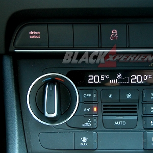 Tombol pengatur suhu dan fitur mode pengendaraan Audi Q3