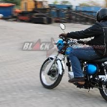 riding Kawasaki Estrella 250